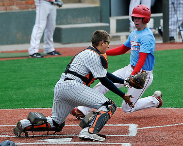 Chisholm's Bailey Cross begins his slide around Fairview catcher, Hunter Kahn, Thursday during the first day of the Merrifield Tournament at David Allen Memorial Ballpark. (Staff Photo by BILLY HEFTON)