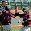 Pioneer's Sage Lamunyon and Kamen Lounsbury celebrate after scoring two runs for the Mustangs during the Merrifield Office Plus Invitational at David Allen Memorial Ballpark Friday, April 18, 2014. (Staff Photo by BONNIE VCULEK)