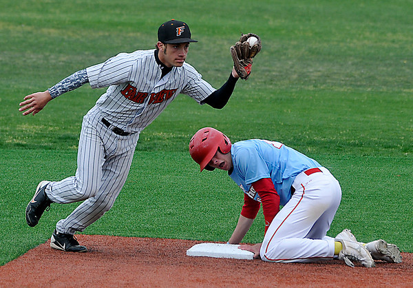 Fairview's Jensen Smith shows the ball to the umpire after tagging out Chisholm's Luke Ball Thursday during the first day of the Merrifield Tournament at David Allen Memorial Ballpark. (Staff Photo by BILLY HEFTON)