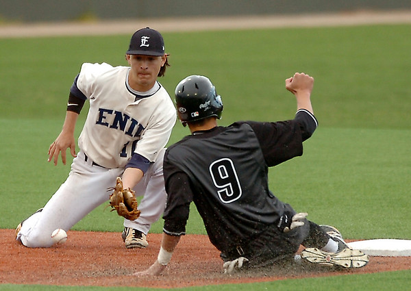 Enid's Cole Floyd loses the ball as tries to tag Broken Arrow's Blake Biggs Monday at David Allen Memorial Ballpark. (Staff Photo by BILLY HEFTON)