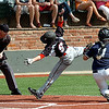 Enid's Kros Bay tags Hunter Newkirk of Tulsa Union Saturday at David Allen Memorial Ballpark. (Staff Photo by BILLY HEFTON)