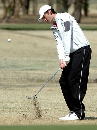 Andy Pickle chips on the 8th green Saturday at Meadowlake Golf Course. (Staff Photo by BILLY HEFTON)