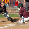 Pioneer's Kade Cronkhite slides across the plate as Frontier's Tristan Harris reaches for the ball during the Class A District baseball winner's bracket game at John D. Riesen Field Thursday, April 24, 2014. (Staff Photo by BONNIE VCULEK)