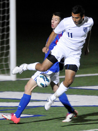 Enid's Felix Mora tries to gain control of the ball in front of a Bixby defender Friday at D. Bruce Selby Stadium. (Staff Photo by BILLY HEFTON)