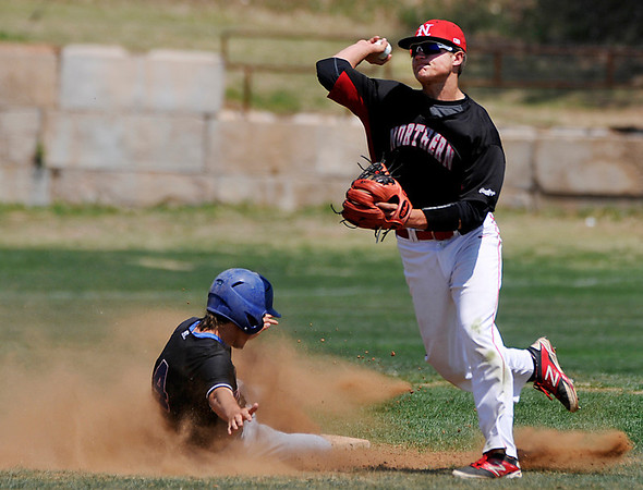 NOC Enid's Nick Yoning avoids Austin Suter of Carl Albert to complete a double play Friday at Failing Field on the NOC campus. (Staff Photo by BILLY HEFTON)