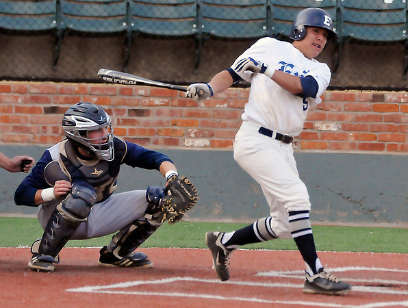 Enid's Hunter Childs connects on his second double against Bartlesville Monday at David Allen Memorial Ballpark. (Staff Photo by BILLY HEFTON)