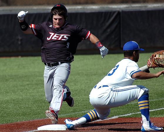 NOC Enid's Daniel Davila beats out a bunt for a base hit as Northern Iowa Area Community College's Juan De La Cruz wait on the ball Monday March 14, 2014 at David Allen Ballpark. (Billy Hefton / Enid News & Eagle)