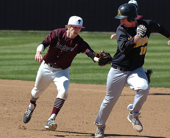 Pioneer's Kade Cronkhite runs down Alva's Max Parsons between first and second base Tuesday March 15, 2016 at Pioneer High School. (Billy Hefton / Enid News & Eagle)