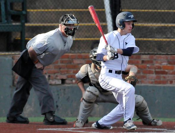 Enid's Tanner Lingenfelter hits a RBI single against Putnam City Friday March 25, 2016 at David Allen Ballpark. (Billy Hefton / Enid News & Eagle)