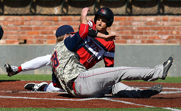 NOC Enid's T.J. Black slides into home pass Northland's Lucas Sandsmark Friday March 3, 2017 at David Allen Ballpark. (Billy Hefton / Enid News & Eagle)
