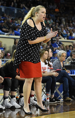 Kremlin-Hillsdale coach, Tana Gragg, encourages her players during the class B state championship game against Lomega Saturday March 4, 2017 at the State fair Arena in Oklahoma City. (Billy Hefton / Enid News & Eagle)