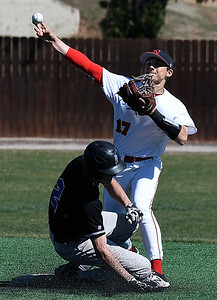 NOC Enid's T.J. Black throws over Butler's Jarvis Lawson to complete a doubleplay Wednesday March 1, 2017 at Failing Field. (Billy Hefton / Enid news & Eagle)