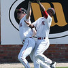NOC Enid's Wade Hanska and Bryan Pacheco collide while making a catch against Ellsworth CC Thursday March 9, 2017 at David Allen Ballpark. (Billy Hefton / Enid News & Eagle)