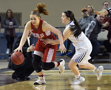 Kremlin-Hillsdale's Kalli Rundle dribbles upcourt against Lomega's Maci Mendall during the class B state championship game Saturday March 4, 2017 at the State Fair Arena in Oklahoma City. (Billy Hefton / Enid News & Eagle)