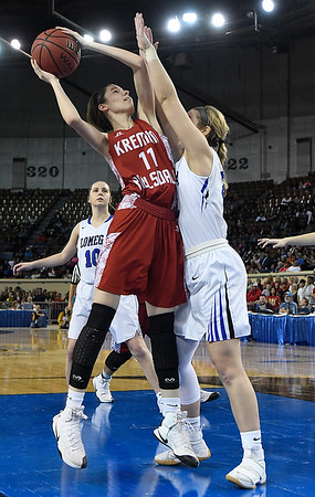 Kremlin-Hillsdale's Rebecca Wasson shoots over Lomega's Rachel Yost during the class B state championship game Saturday March 4, 2017 at the State Fair Arena in Oklahoma City. (Billy Hefton / Enid News & Eagle)