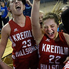 Kremlin-Hillsdale's Jordan Harris and Daylan Dulinsky celebrate following a 53-46 win over Lomega in the class B state championship game Saturday March 4, 2017 at the State Fair Arena in Oklahoma City. (Billy Hefton / Enid News & Eagle)