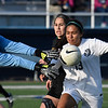 Enid's Lizbeth Ramirez challenges the Sand Springs goalkeeper Friday March 31, 2017 at D. Bruce Selby Stadium. (Billy Hefton / Enid News & Eagle)