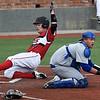 NOC Enid's Griffin Keller slides behind Pratt CC catcher, Clayton Beaver, to score Tuesday March 28, 2017 at David Allen Ballpark. (Billy Hefton / Enid News & Eagle)