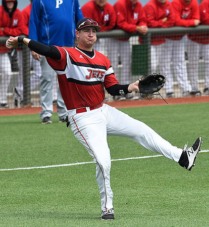 NOC Enid's Matt Conerly makes an off balance throw to first against Pratt CC Tuesday March 28, 2017 at David Allen Ballpark. (Billy Hefton / Enid News & Eagle)