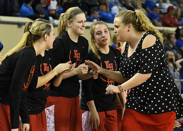 Kremlin-Hillsdale coach, Tana Gragg, starts to celebrate with players on the bench during the class B state championship game against Lomega Saturday March 4, 2017 at the State fair Arena in Oklahoma City. (Billy Hefton / Enid News & Eagle)