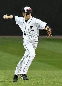 Enid's Ambrien Voitik makes a throw to first against Sand Springs Tuesday March 7, 2017 at David Allen Ballpark. (Billy Hefton / Enid News & Eagle)