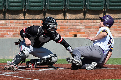 NOC Enid's Case Harper tags out Ellsworth CC's Sebastian Holte-Mancera Friday March 10, 2017 at David Allen Ballpark. (Billy Hefton / Enid News & Eagle)