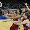 Members of the Kremlin-Hillsdale lady Broncs race to grab the state championship trophy following a 53-46 win over Lomega in the class B state championship game Saturday March 4, 2017 at the State Fair Arena in Oklahoma City. (Billy Hefton / Enid News & Eagle)