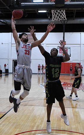 NOC Enid's Tony Hall goes to the basket against Western Oklahoma's Darron Johnson Thursday March 1, 2018 at the NOC Mabee Center. (Billy Hefton / Enid News & Eagle)