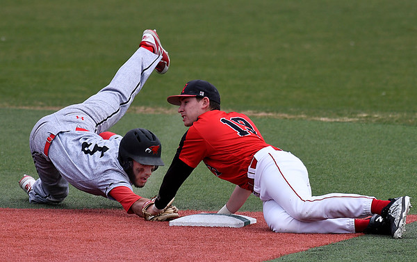 NOC Enid's Tyler Wood tags out NE Nebraska's Donovan Warren at second base Saturday March 17, 2018 at David Allen Memorial Ballpark. (Billy Hefton / Enid News & Eagle)