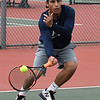 Enid's Bryan Alvarado returns a shot during the Enid Invitational Tournament Monday March 26, 2018 at Crosslin Park. (Billy Hefton / Enid News & Eagle)
