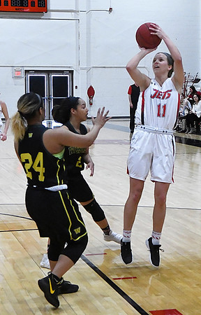 NOC Enid's McKenna Pulley shoots over Western Oklahoma's Mariah Watson and Paradize Jackson Thursday March 1, 2018 at the NOC Mabee Center. (Billy Hefton / Enid News & Eagle)