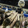 Members of the Seiling basketball team hold up the state championship trophy after defeating Frontier 60-57 Saturday March 3, 2018 at the State Fair Arena in Oklahoma City. (Billy Hefton / Enid News & Eagle)