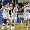 (left to right) Seiling's Karly Gore, Raylee Tautfest and Macy Gore run to join their team mates after defeating Frontier 60-57 to win the class A state championship Saturday March 3, 2018 s at the State Fair Arena in Oklahoma City Saturday March 3, 2018. Tautfest finished with a game high 32 points. (Billy Hefton / Enid News & Eagle)