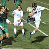 Enid's Chase KIng kicks the ball away from Bishop McGuinness' Andrew Wisniewski Tuesday March 13, 2018 at D. Bruce Selby Stadium. (Billy Hefton / Enid News & Eagle)