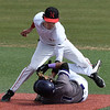 NOC Enid's D.J. Calvert tags out Ellsworth CC's Pastor Sanchez trying to steal second Friday March 9, 2018 at David Allen Memorial Ballpark. (Billy Hefton / Enid News & Eagle)