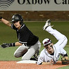 Enid's Ambren Voitik and Woodward's Ty Wiggins look to first to see the result of a double play March 9, 2018 at David Allen Memorial Ballpark. (Billy Hefton / Enid News & Eagle)