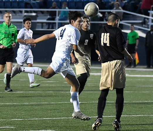 Enid's Fernando Prosperd heads the ball towards goal against Woodward Thursday March 8, 2018 at D. Druce Selby Stadium. (Billy Hefton / Enid News & Eagle)