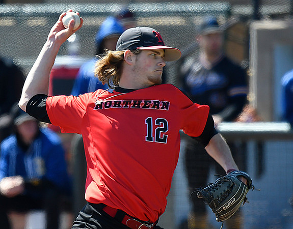 NOC Enid's Kyler Patterson delivers a pitch against Northern Iowa Area CC Monday March 12, 2018 at David Allen Memorial Ballpark. (Billy Hefton / Enid News & Eagle)