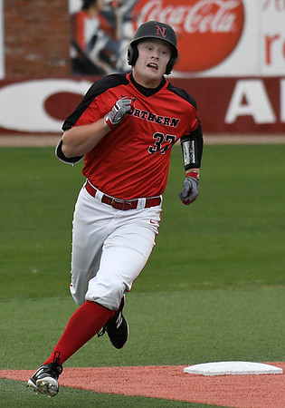 NOC Enid's Griffin Keller heads to third with a triple against Rose State Monday March 26, 2018 at David Allen Memorial Ballpark. (Billy Hefton / Enid News & Eagle)