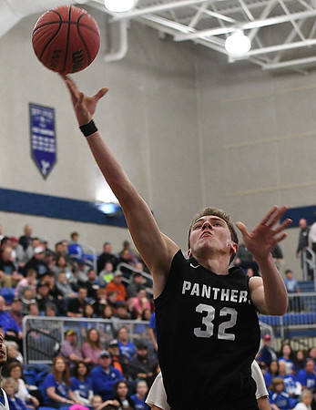 Pond Creek-Hunter's Mason Hart puts up a shot against Cyril Thursday March 1, 2018 during the quarterfinals of the state tournament at Deer Creek High School. (Billy Hefton / Enid News & Eagle)