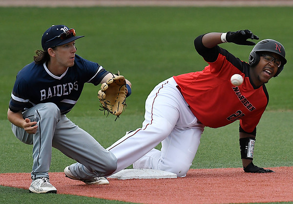 NOC Enid's E.J. Taylor slides into second with a stolen base as Rose State's Mack Thompson waits on the ball Monday March 26, 2018 at David Allen Memorial Ballpark. (Billy Hefton / Enid News & Eagle)