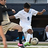 Enid's Alex Ramirez gets in front of a Woodward defender Thursday March 8, 2018 at D. Druce Selby Stadium. (Billy Hefton / Enid News & Eagle)
