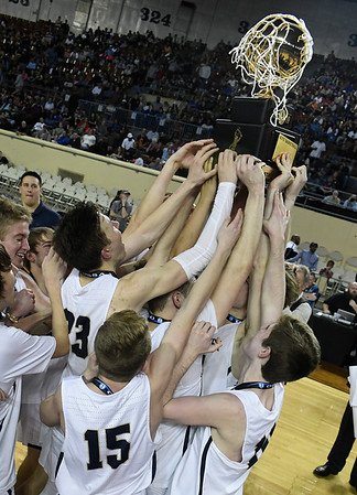 Kingfisher players hold the state championship trophy after defeating Heritage Hall Saturday March 9, 2019 at the Sate Fair Arena in Oklahoma City. (Billy Hefton / Enid News / Eagle)