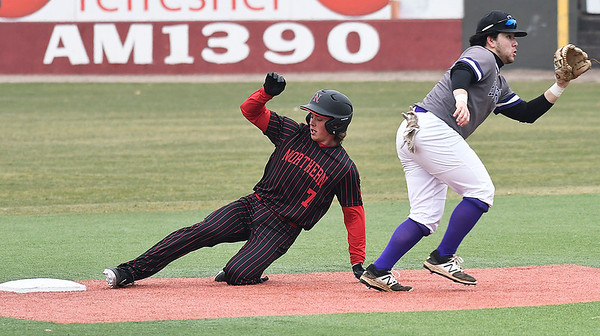 NOC Enid's Dylan Caplinger slides into second Ellsworth CC's Victor Lara with a stolen base Friday March 8, 2019 at David Allen Memorial Ballpark. (Billy Hefton / Enid News & Eagle)