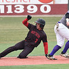 NOC Enid's Dylan Caplinger slides into second Ellsworth CC's Victor Lara with a stolen base Friday March 8, 2019 at David Allen Memorial Ballpark. (Billy Hefton / Enid News & Eagle)