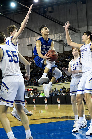 Hennessey's Angel Rodriguez goes up int he lane against Rejoice Christian in the Class 2A state championship game Saturday March 9, 2019 at the Sate Fair Arena in Oklahoma City. (Billy Hefton / Enid News / Eagle)