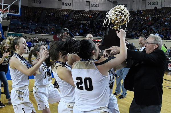 Seiling players grab the state championship trophy following the Lady Cats' 76-41 win over Hydro-Eakly in the Class A state championship game Saturday March 2, 2019 at the State Fair Arena in Oklahoma City. (Billy Hefton / Enid News & Eagle)