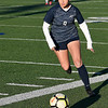 Enid's McKenna Chatterji dribbles upfield against Piedmont Tuesday March 5, 2019 at D. Bruce Selby Stadium. (Billy Hefton / Enid News & Eagle)