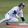 Enid's Connor Gore slides into second base against Southmoore during the Plainsmen's home opener Monday March 11, 2019 at David Allen Memorial Ballpark. (Billy Hefton / Enid news & Eagle)