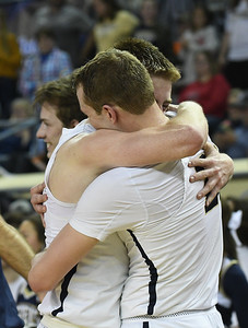Kingfisher's Jett Sternberger and Trey Green hug following the Yellowjacket's win over Heritage Hall in the Class 4A state championship game Saturday March 9, 2019 at the Sate Fair Arena in Oklahoma City. (Billy Hefton / Enid News / Eagle)